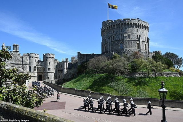 The Military procession proceeds through the grounds of Windsor Castle ahead of the funeral of Prince Philip following his death at 99