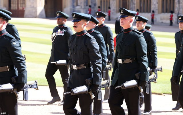 Members of the military marching in the Engine Court ahead of the funeral of the Duke of Edinburgh in Windsor Castle