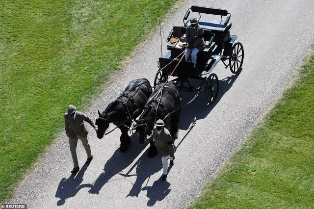 Fell ponies, Balmoral Nevis and Notlaw Storm, pull the Duke of Edinburgh's carriage as it arrives at Windsor Castle