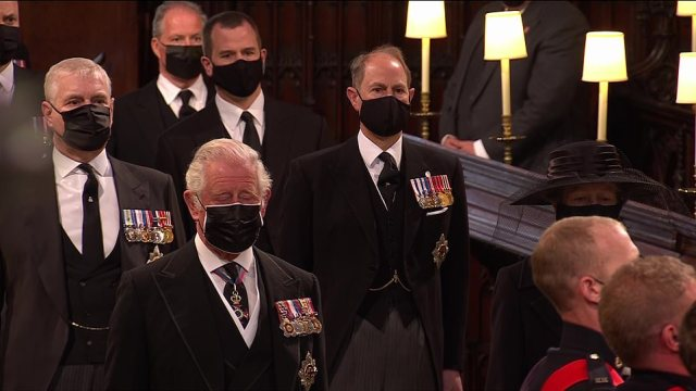 Prince Charles blinks away tears as he follows the coffin into the church with his brothers Andrew and Edward behind him