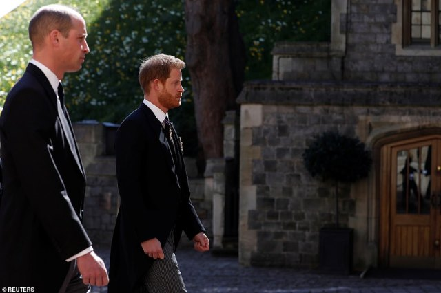 Prince William and Prince Harry follow the hearse towards St George's Chapel at Windsor Castle this afternoon