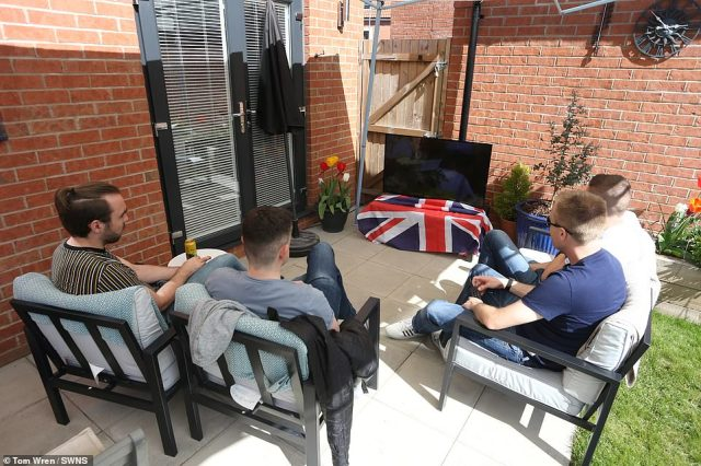 Pete Davey, Rob Parry-Hall, Mike Clements and George Hull from Hanham, Bristol watch the funeral of the Duke of Edinburgh