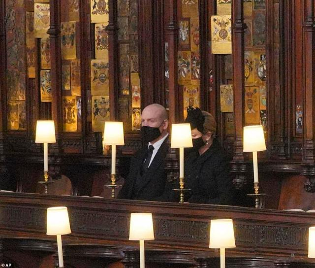 Zara Tindall is pictured beside her husband Mike in St George's Chapel this morning as she mourns the loss of her beloved grandfather