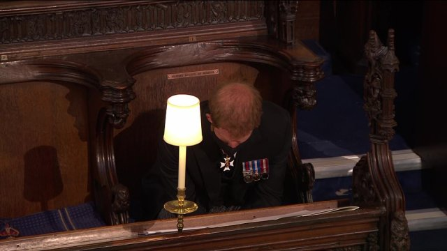 Prince Harry bows his head during Prince Philip's funeral service at St George's Chapel following the Duke of Edinburgh's death