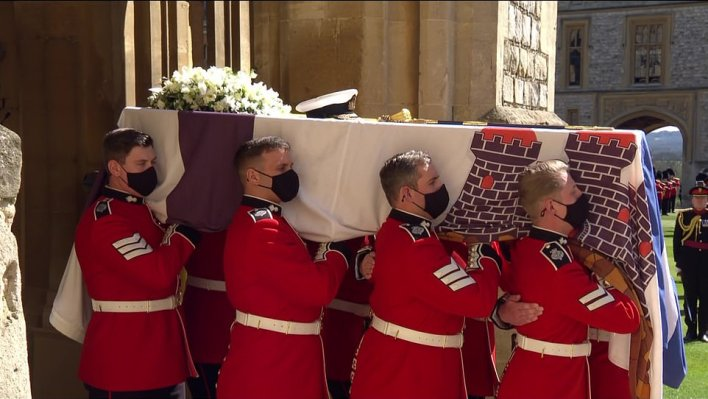 Prince Philip's coffin descended from Windsor Castle as the royal family attended the funeral of the queen in mourning for her husband