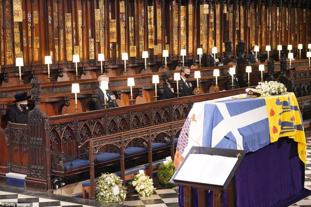 Queen Elizabeth II (left) looks at the coffin of Prince Philip, Duke of Edinburgh, during his funeral at St George's Chapel at Windsor Castle