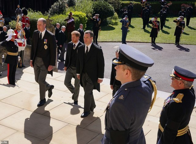 The Duke of Cambridge, the Duke of Sussex and Peter Phillip walk up the West Steps outside St George's Chapel, Windsor Castle