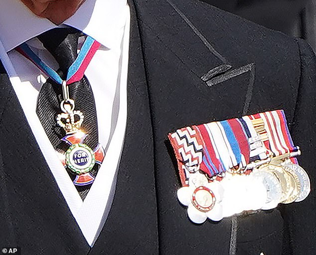 Dressed in a black morning suit, Charles wore medals including: a garter star, an Order of Merit, the Queen's Service Order (New Zealand), Coronation Medal, Silver Jubilee Medal, Golden Jubilee Medal, Diamond Jubilee Medal, Naval Long Service Good Conduct (LSGC), Canadian Forces Decoration, The New Zealand Commemmorative Medal, and the New Zealand Armed Forces Award.