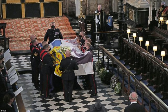 Prince Philip's funeral service included a hymn to honour his service at sea, a psalm that was sung at his 75th birthday party and buglers from the Royal Marines who played the Navy's 'Action Stations' battle signal. Pictured: The Queen watches on as the Duke of Edinburgh's coffin is placed on a catafalque on a marble slab in the Quire