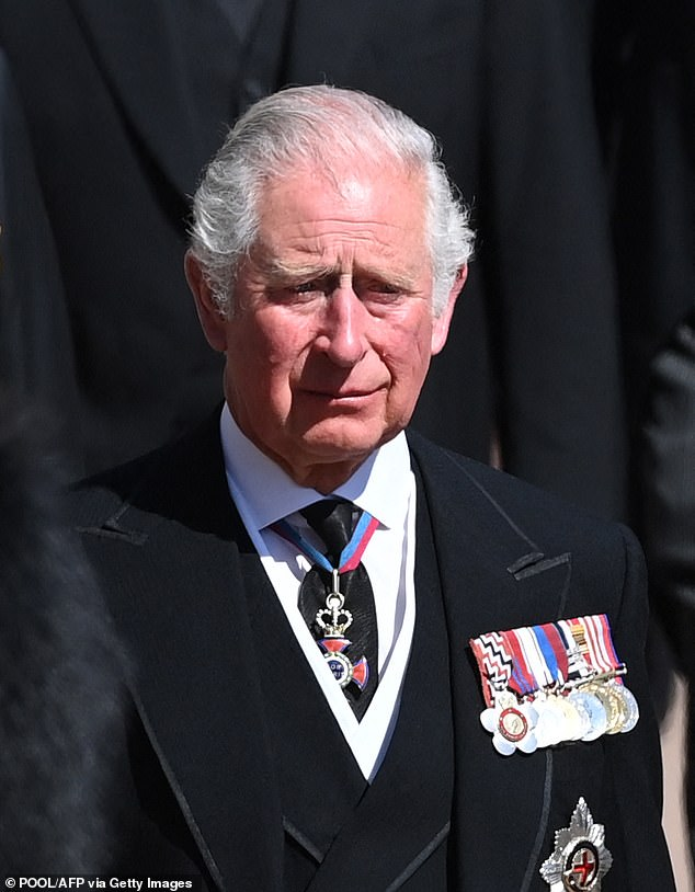 A tear rolled down Prince Charles' (pictured) cheek during his father Prince Philip's funeral this afternoon as he followed the Duke of Edinburgh's coffin while accompanied by his sons Prince William and Prince Harry