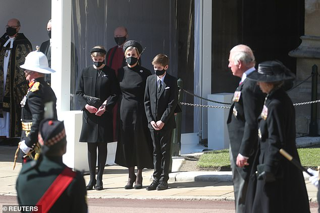 Sophie and Prince Edward's 17-year-old daughter cut an elegant figure in a black cloak dress, similar to her mother's set from Suzannah London, when she attended Prince Philip's funeral at St. George in Windsor (pictured)