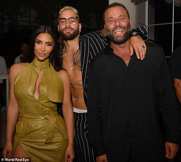 Heartthrob: The Latin heartthrob showed off his toned abs in an unbuttoned black-and-white striped suit, letting his white Calvin Klein underwear peek at his sun-kissed hips.