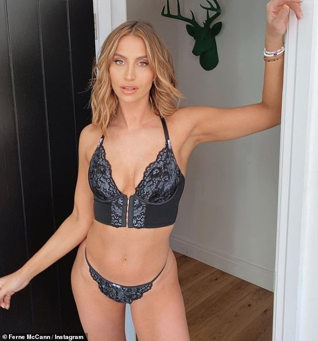 Gorgeous: The TOWIE star sizzled in the dark in two-piece, putting her toned physique on full display while posing in one of the doorways of her home