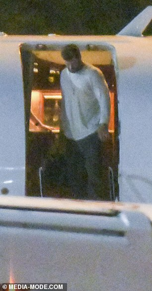 A-list pal:Chris (pictured), 37, exited the aircraft in a casual ensemble