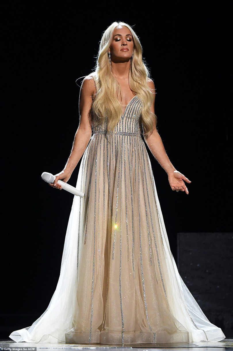 Stunning: Carrie Underwood appeared against a completely black stage to give a moving a capella performance of Amazing Grace at the 56 Academy of Country Music Awards in Nashville on Sunday
