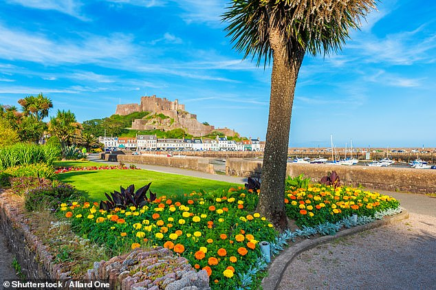Tourists will be able to visit Jersey, pictured, from April 26. Pictured is Gorey Castle and the harbour of Saint Martin