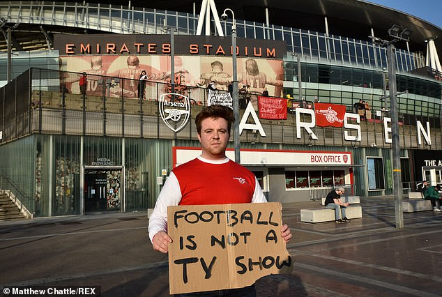 This Arsenal supporter demonstrated against the plan at the Gunners' stadium, The Emirates