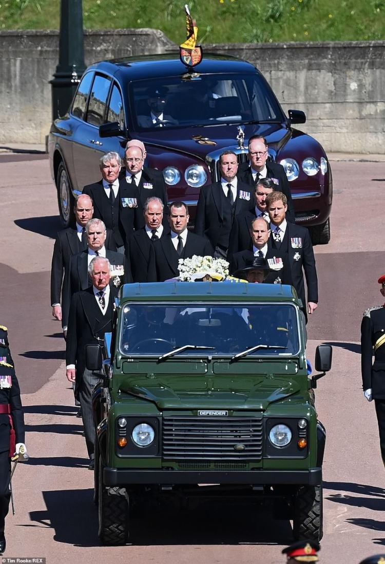 The Duke of Edinburgh's coffin on the back of the Land Rover with royal family members walking behind