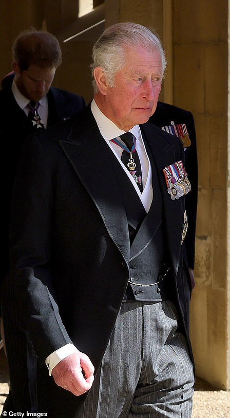 Prince Charles walks behind his father's coffin