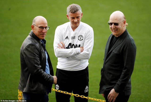 Joel Glazer (left) and Avram Glazer (right) with Ole Gunnar Solskjaer the Manchester United boss