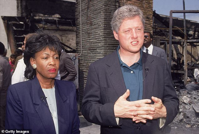 Waters and then-President Bill Clinton tour Los Angeles in May 1992 after rioters burnt buildings to the ground in violent riots