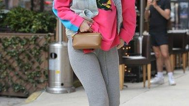 Gigi Hadid keeps it casual in flashy pink-and-blue sweatshirt and boots