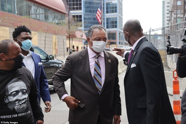 Civil rights leader Rev. Jesse Jackson (center) arrives at the Hennepin County courthouse on Tuesday to await the verdict