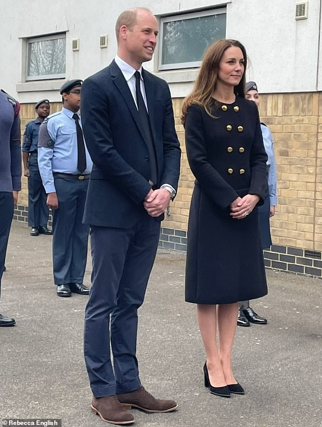 Demure Duchess: The Duchess of Cambridge was the picture of elegance in a favourite D&G coat as she visited an air cadet base today