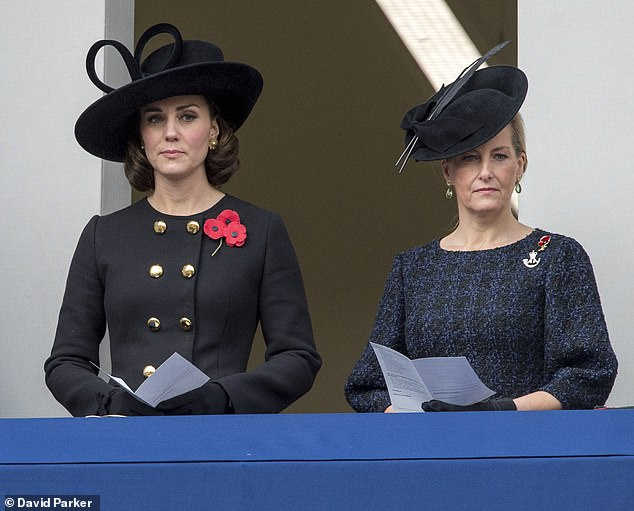Favourite piece: Kate Middleton previously wore the military-inspired coat, which falls to just below the knees, on Remembrance Sunday in 2017 (pictured, with the Countess of Wessex)