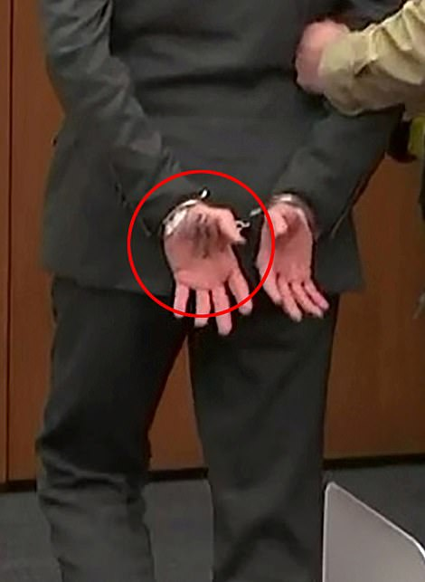 The number is said to have belonged to the former cop's lawyer, Eric Nelson, and was visible as he stood up from his seat