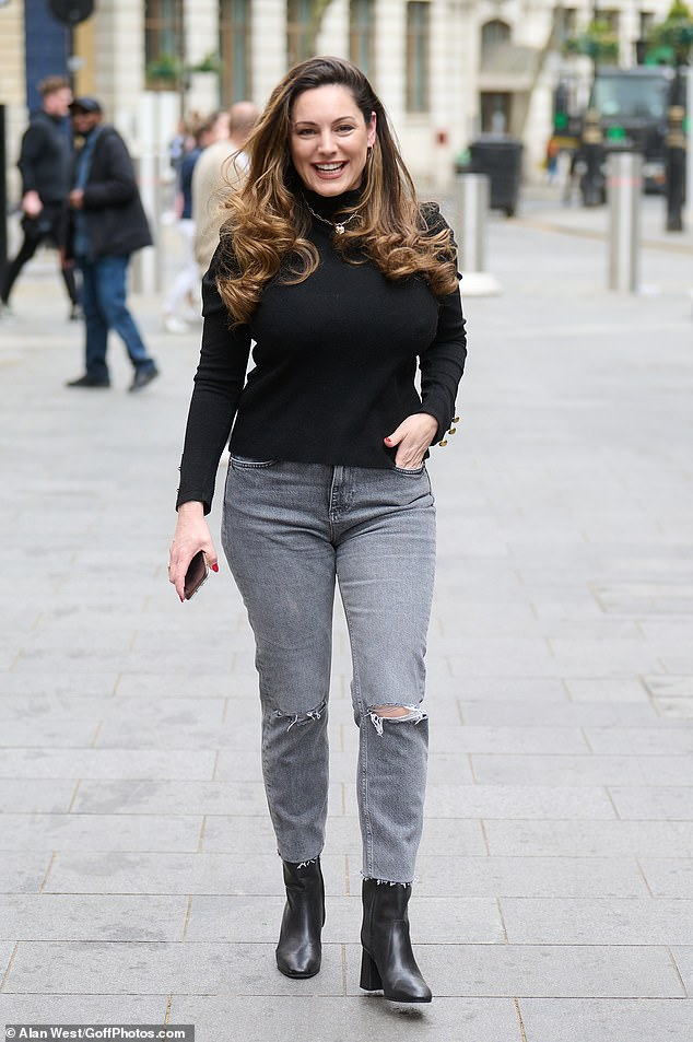 Stylish: Kelly Brook always looked chic when she arrived at Heart FM in London on Wednesday