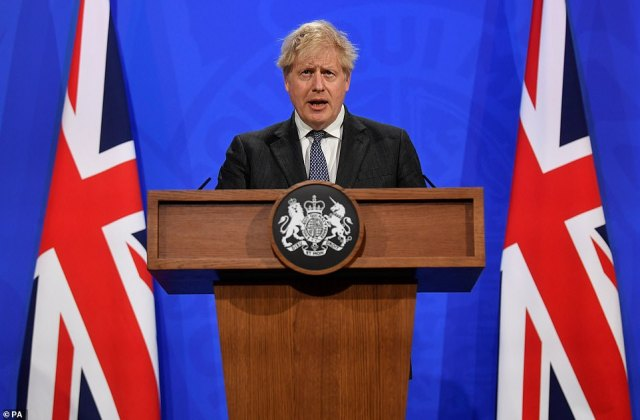 Pictured: Boris Johnson at a media briefing in Downing Street yesterday
