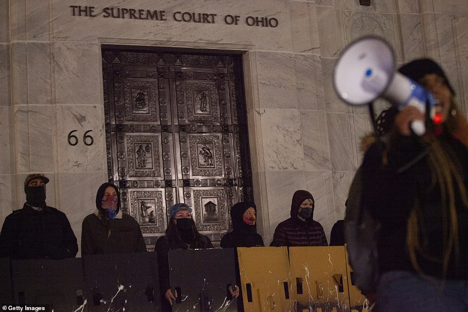 Black Lives Matter activists stand outside of the Supreme Court of Ohio, and denounce the hypocrisy of the judicial system during a protest reacting to the police shooting of MaKhia Bryant