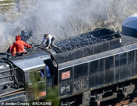 Easy does it: Hayley was seen grabbing onto one end of the coal space after running across it