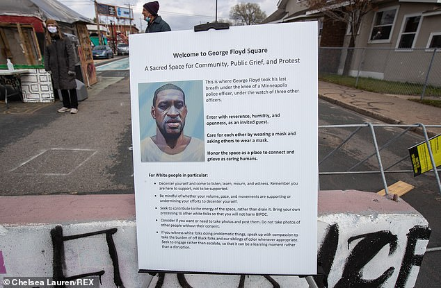 A placard posted at the entrance to George Floyd Square in southern Minneapolis includes a separate set of instructions for white people. The image above was taken on Wednesday