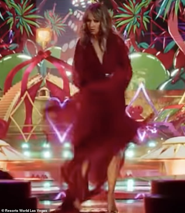 On brand: She was surrounded by animations of quintessential Sin City imagery including the French suits of playing cards and some inflatable palm trees