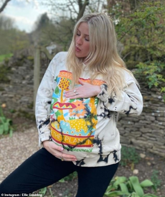Important cause: Pregnant Ellie Goulding looked as radiant as ever as she modelled a jumper by her close 'dear friend' Stella McCartney to mark Earth Day on Thursday