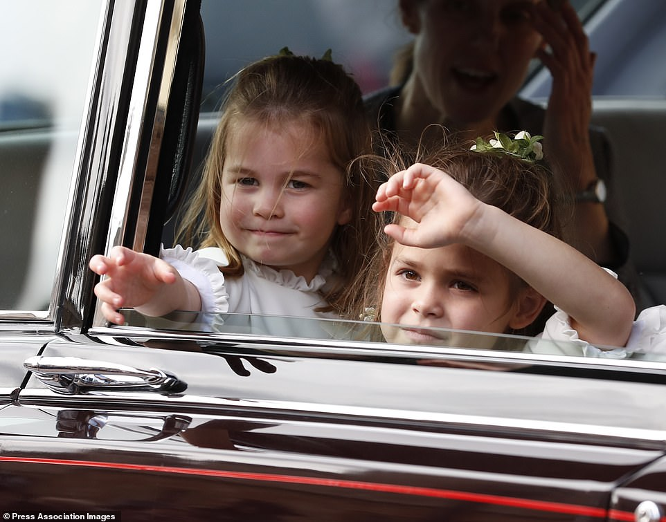 Princess Charlotte waves to the crowd after the wedding of Princess Eugenie of York and Jack Brooksbank in St George's Chapel, Windsor Castle