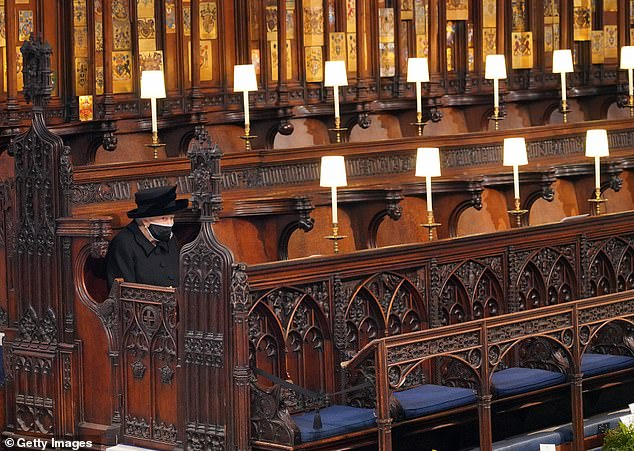 Pictured: The Queen sits alone during Prince Philip's funeral on Saturday