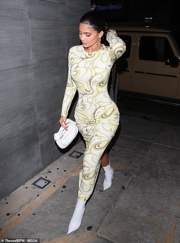 Psychedelic: Jenner, seen stepping out of a beige Mercedes G-Wagon, turned heads in psychedelic Emilio Pucci ensemble