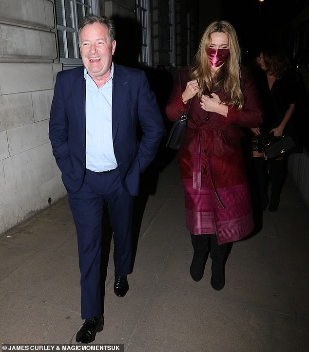 Date night: Meanwhile Piers cut a dapper figure as he enjoyed dinner with wife Celia Walden in London on Thursday