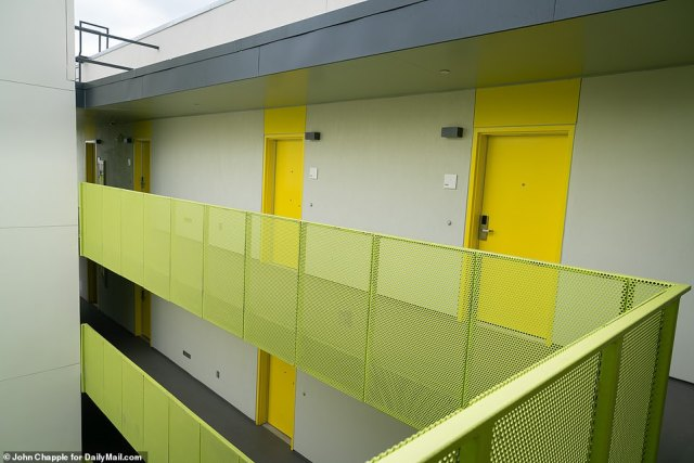 THE NEW: People will be greeted by bright yellow doors to their new studio apartments at the 98-unit building