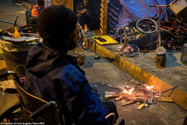 On Thursday night, some people had set a small fire as the temperature had dropped to 55 degrees Fahrenheit