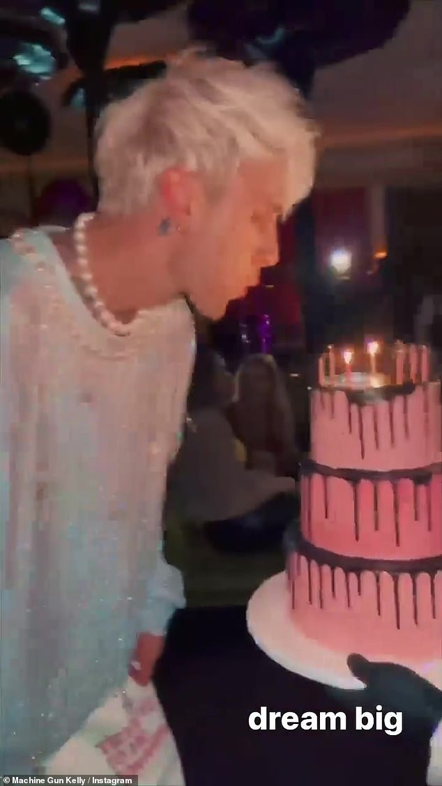 'Dream big': In the video clip, the Houston native born Colson Baker is seen blowing out the candles on his his three tier birthday cake