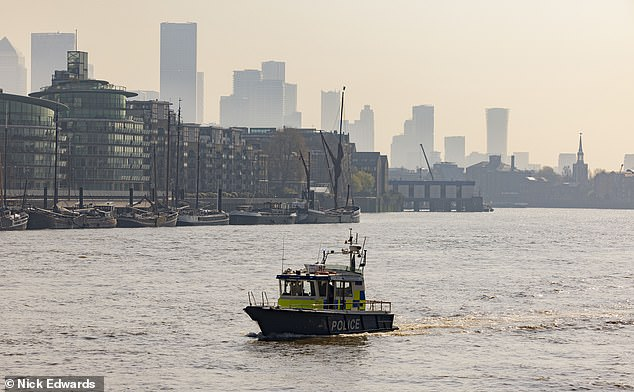 The 13-year-old boy went missing after falling into the River Thames from Tower Bridge (police at the scene) as he was on his way to school, his headteacher said