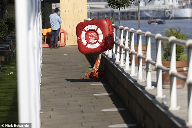 Witnesses described hearing screams before one woman jumped into the water to try and save the boy. Despite using a life-float (pictured) to swim into the Thames, she was only able to recover his school jacket and school bag