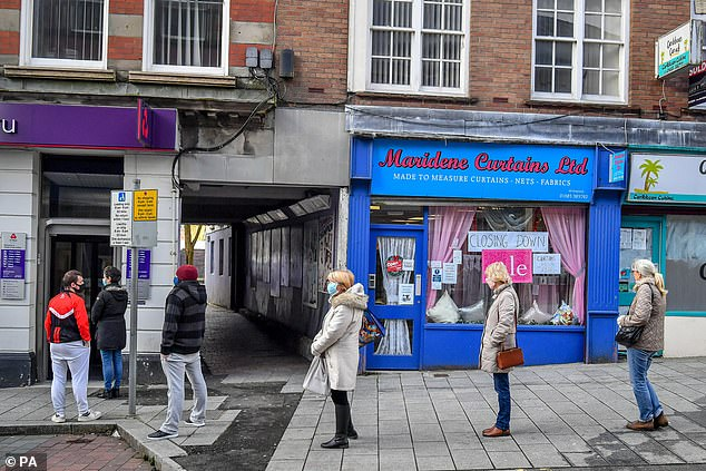 Queues outside a NatWest branch in Merthyr Tydfil, Wales, last December