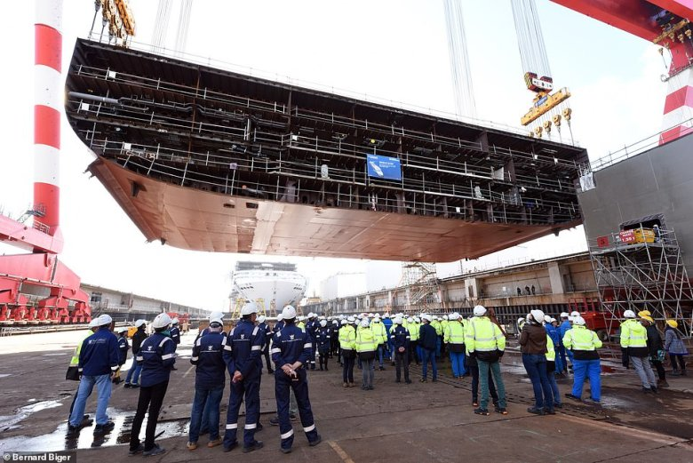 The vessel's keel is lowered into place in a ceremony at a shipyard in Saint Nazaire in October 2019, marking the start of the ship's physical construction