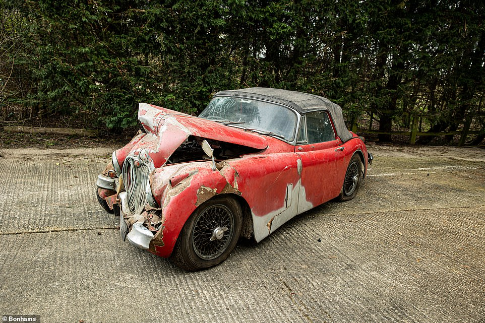 Drophead that looks like it was dropped from a height: This 1960 Jaguar XK150 3.8 S Drophead Coupe has certainly seen better days. It is due to be sold at auction for around £10,000 to £15,000 - but is worth far more than that once fully restored