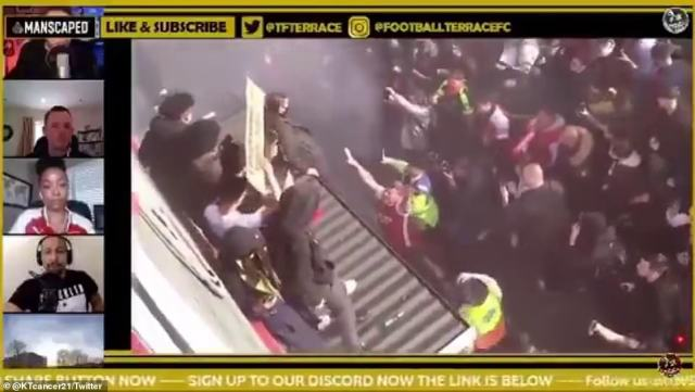 The stricken fan can be seen trying to get off the top of the Arsenal ticket office roof
